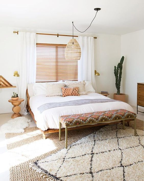 Desert Boho Bedroom With A Wicker Lamp
