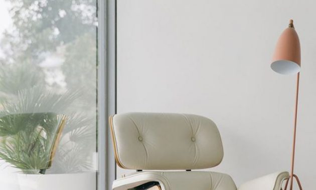 Eames Lounge Chair Of Plywood And White Leather