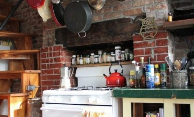 Eclectic Kitchen With Whitewashed Red Brick Wall