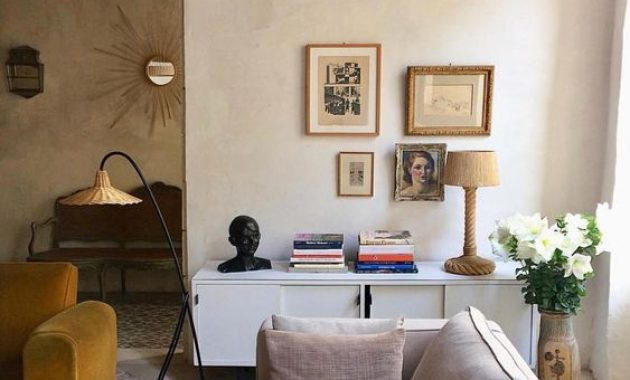 Eclectic Living Room With Plaster Walls And A Metal And Wicker Floor Lamp