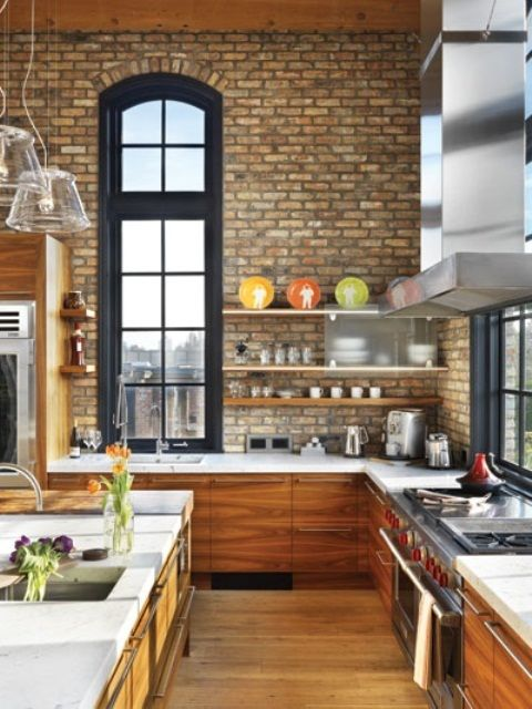 Kitchen With Neutral Exposed Brick Walls Paired With Amber Wooden Cabinets