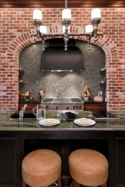 Kitchen With Red Brick Wall And Grey Tiles And Green Stone Countertop
