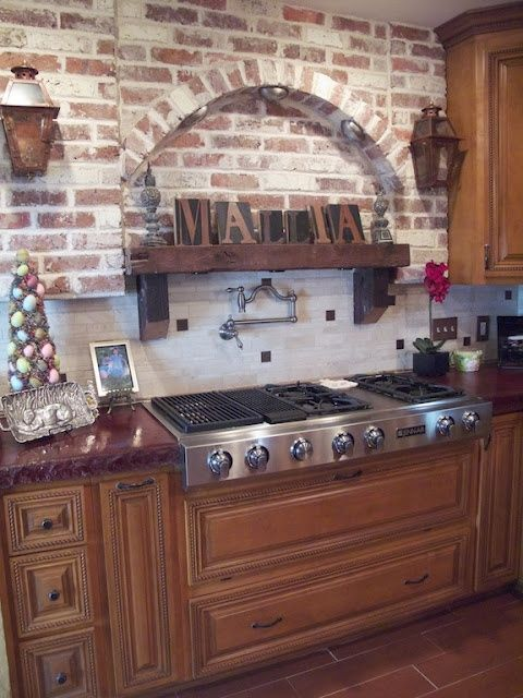 Kitchen With Red Brick Walls And Rich Stained Traditional Furniture