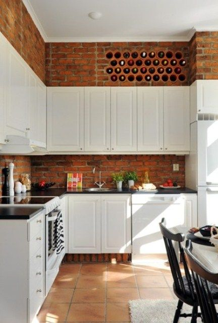 Kitchen With Vintage White Cabinets And Red Bricks