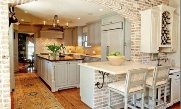 Kitchen With Whitewashed Bricks And Neutral Tiles