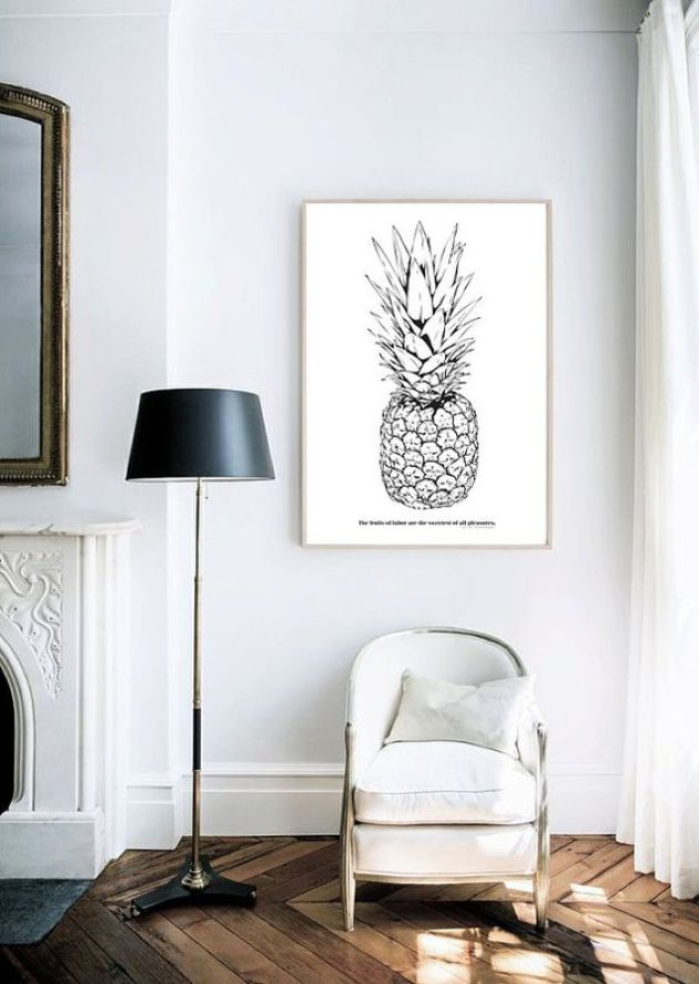 Living Room With Black And White Pineapple Artwork