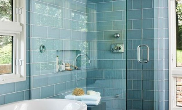 Modern Bathroom With Light Blue Subway Tiles With White Grout And Dark Wooden Floors