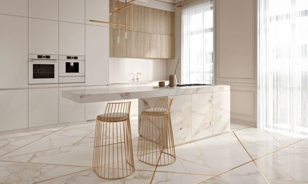 Modern Kitchen Island With Gold Bar Stools And Pendant Lights