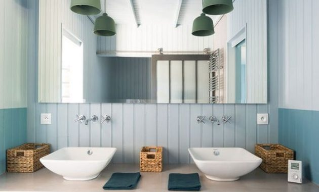 Modern Light Blue Bathroom With Beadboard And A Concrete Vanity