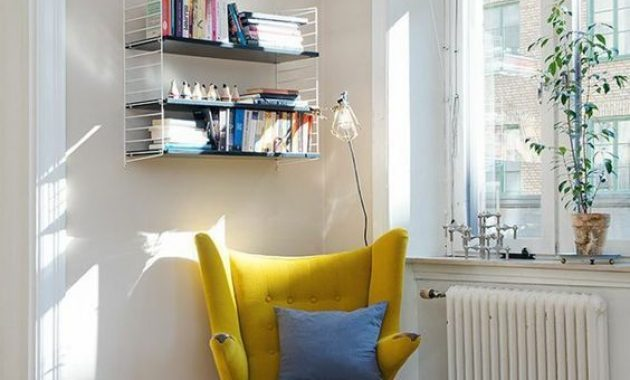 Mustard Wingback Reading Chair With A Blue Pillow