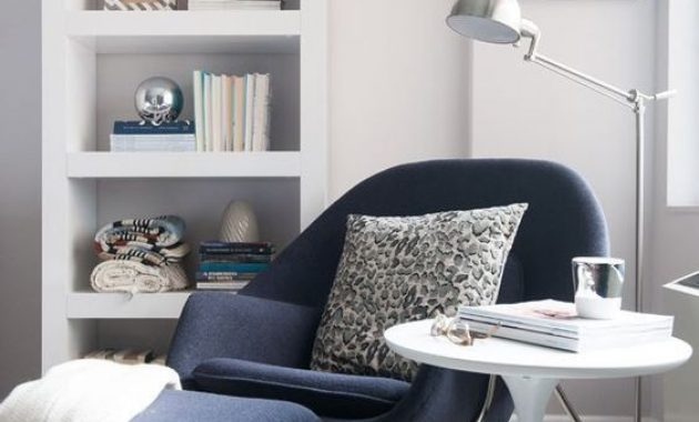 Navy Reading Chair And A Footrest On Tall Metal Legs