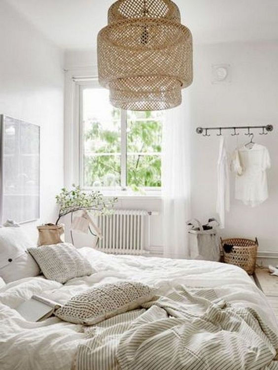 Neutral Bedroom With A Large Wicker Lamp