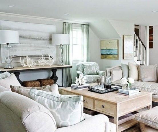 Off-White And Aqua Beach Living Room With A Vintage Coffee Table