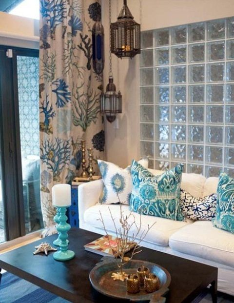 Sea-Inspired Living Room With A Light Blue Glass Wall