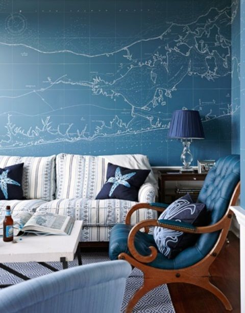 Sea-Inspired Living Room With An Accent Map Blue Wall