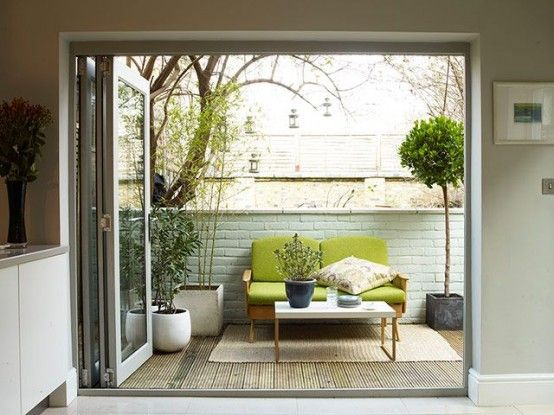 Small And Cozy Mid-Century Modern Terrace Design Ideas With Potted Greenery