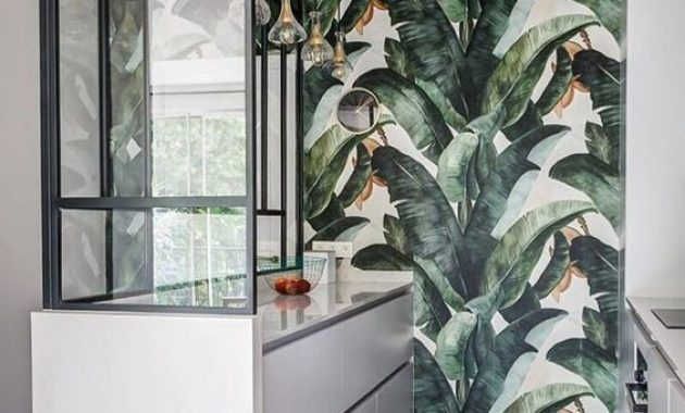 Small And Minimalist Tropical Kitchen With Sleek White Cabinets
