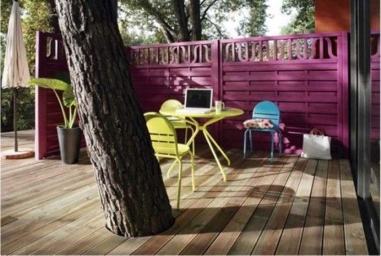 Small Bright Terrace With A Fuchsia Wall And Bright Yellow Furniture