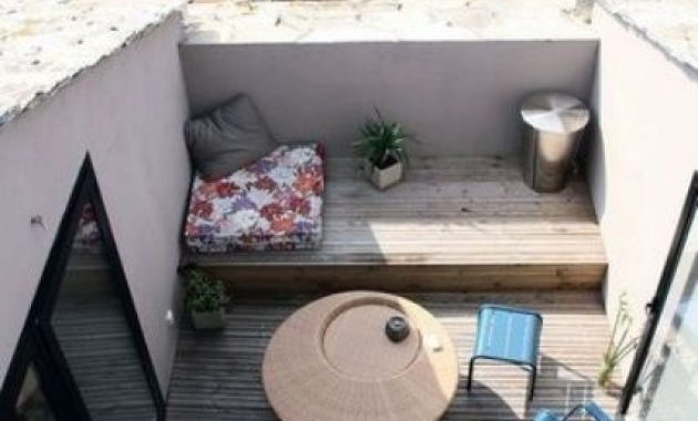 Small Terrace Design Ideas With A Beach View And Blue Chairs And A Wicker Table