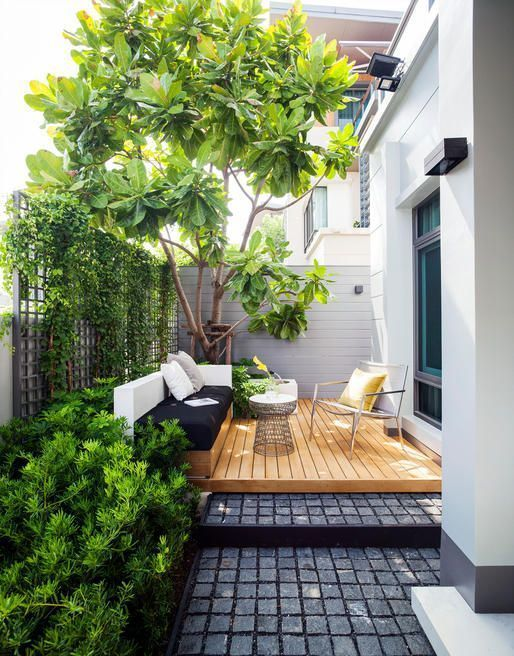 Small Terrace Design Ideas With A Comfy Chair And A Coffee Table