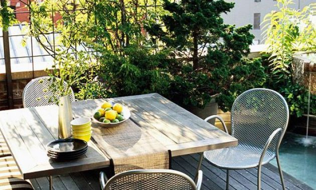 Small Terrace Design Ideas With Metal Chairs And A Mini Garden In Pots