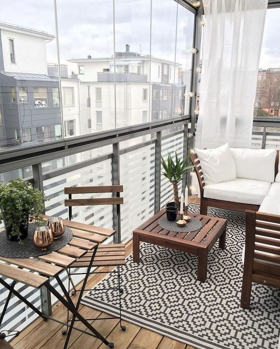 Small Terrace Design Ideas With Simple Stained Furniture And Some Greenery