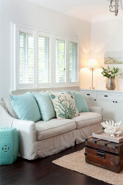 Small White Beach Living Room With Touches Of Turquoise