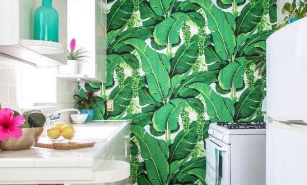 Tropical Kitchen With Sleek White Cabinets With A Banana Leaf Print