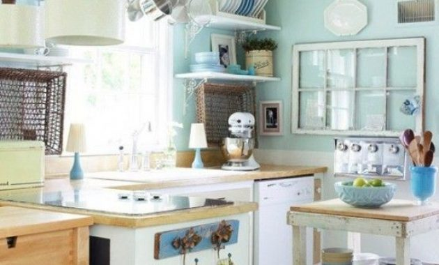 Vintage-Inspired Small Aqua Kitchen With Neutral Cabinets And Light Stained Countertops