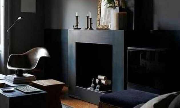 Welcoming Dark Masculine Room With Black Walls And A Fireplace