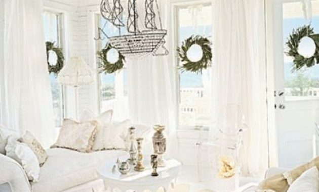 White Coastal Living Room With White Furniture And Curtains