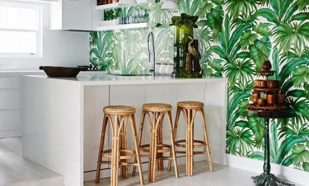 White Tropical Kitchen With A Tropical Leaf Print Wall