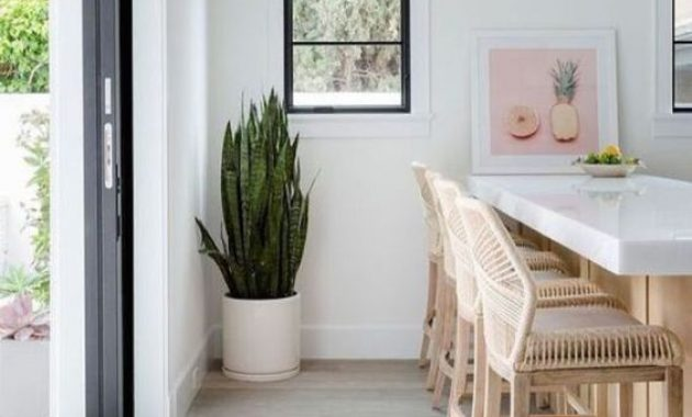 White Tropical Kitchen With Rattan Stools