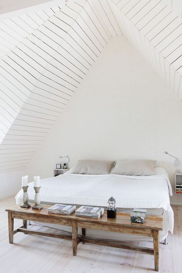 Attic Bedroom In Creamy Shades With A Neutral Wooden Floor