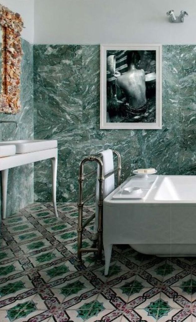 Bathroom With Green Marble Tiles On The Walls And Mosaic Tiles On The Floor