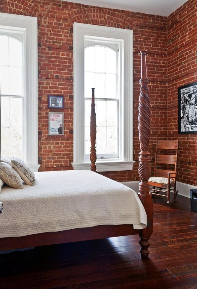Bedroom With Red Brick Walls And A Redwood Floor