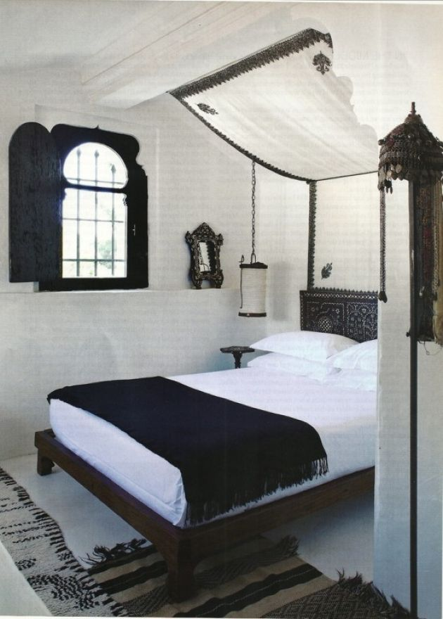 Black And White Moroccan Bedroom With A Shuttered Window
