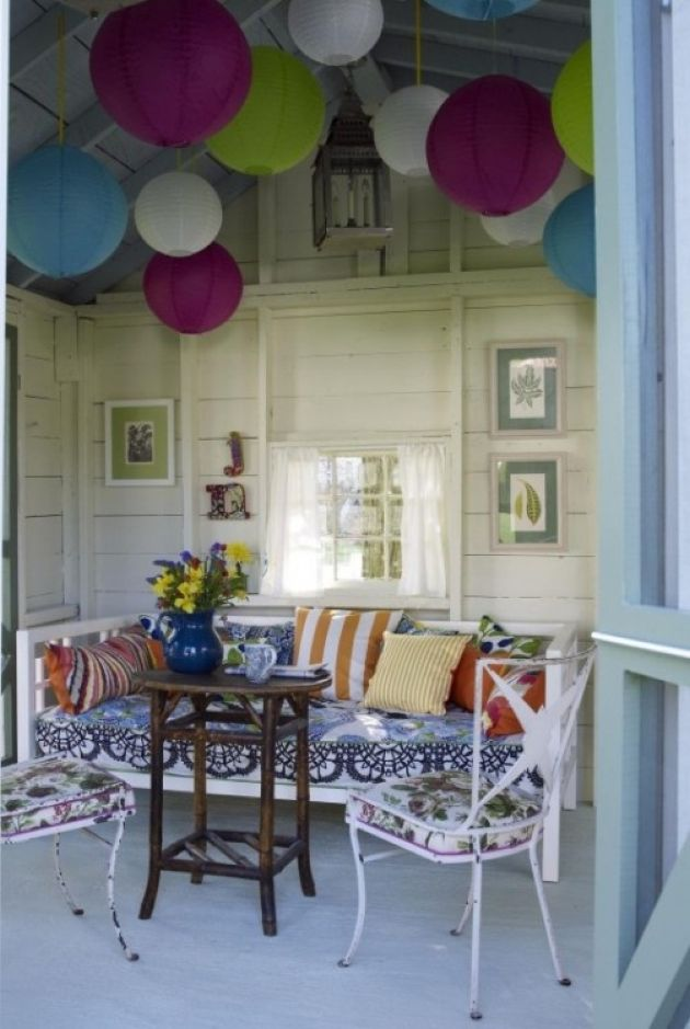 Bohemian Patio With Colorful Paper Lanterns And White Furniture