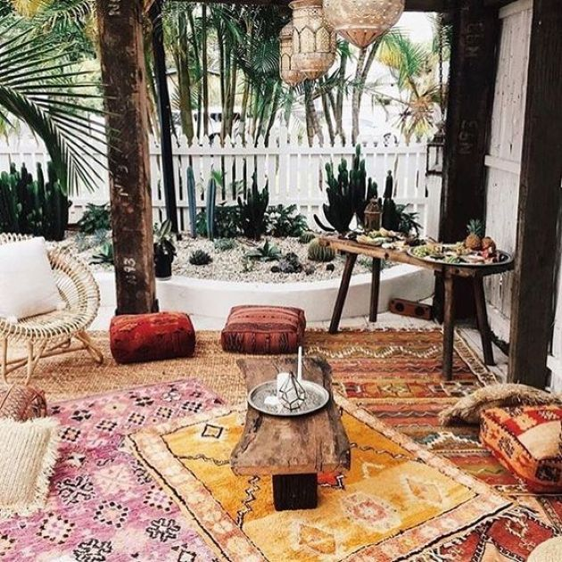Boho Patio With Colorful Printed Rugs And Cushions