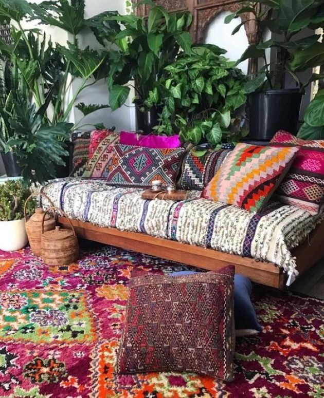 Bright Boho Patio With A Wooden Bench With Printed And Colorufl Upholstery