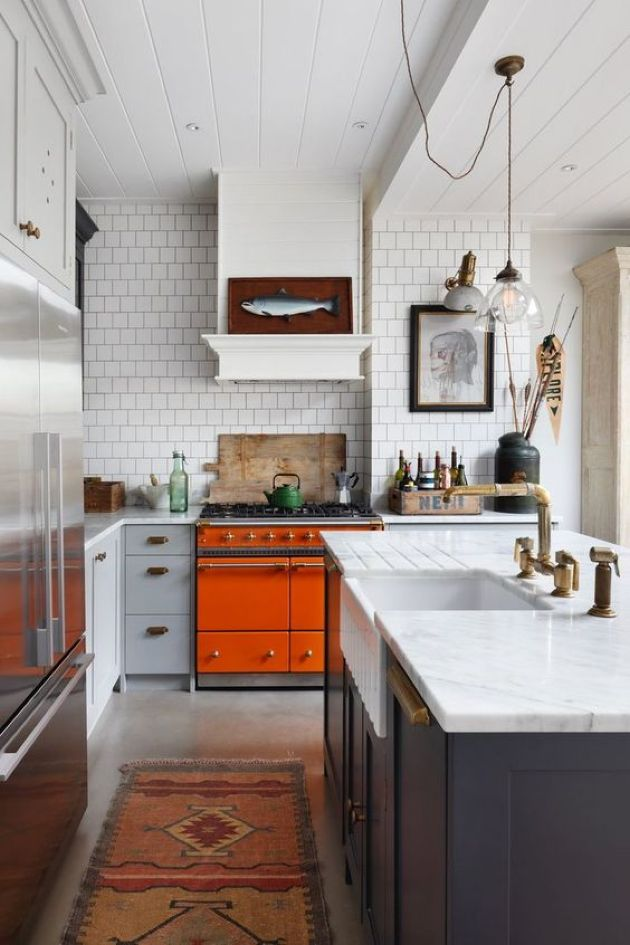 Bright Eclectic Kitchen With An Orange Cooker