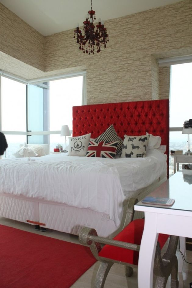Bright Glam Bedroom With Bright Red Touches And A Faux Stone Statement Wall