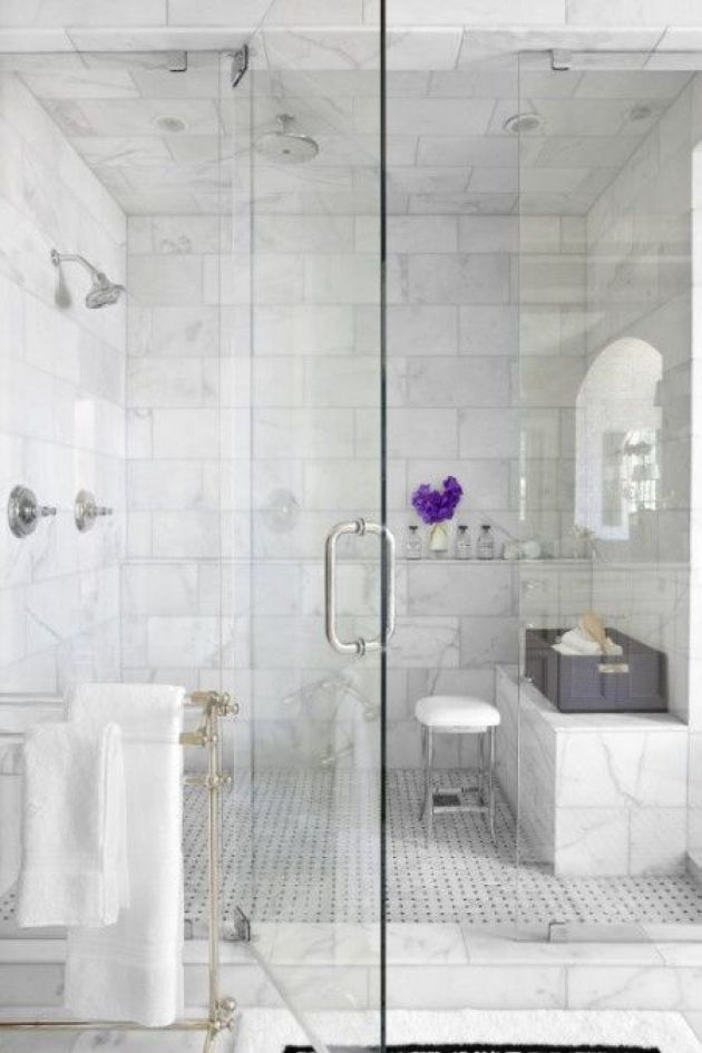 Chic Shower Space With Marble Tiles And Matching Patterned Tiles