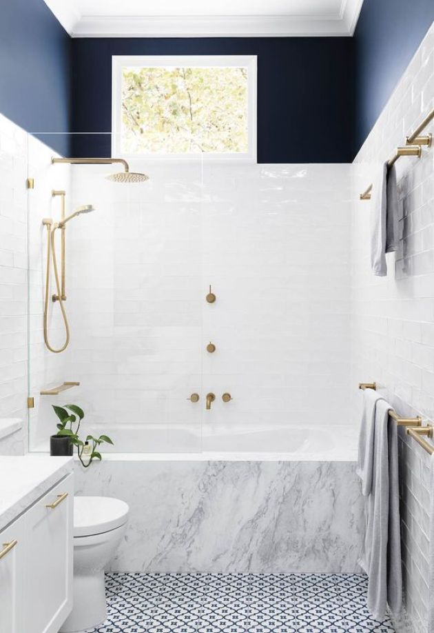 Chic Small Contemporary Bathroom With A Mosaic Floor And A Marble Clad Tub