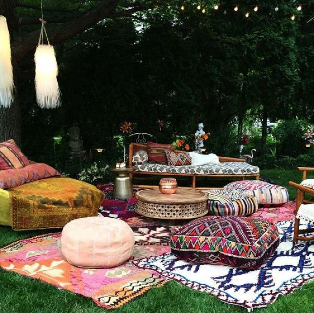 Colorful Boho Patio With Ottomans And Cushions