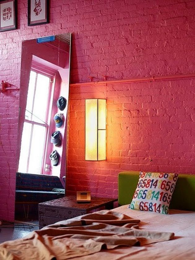 Colorful Modern Bedroom With A Red Brick Wall