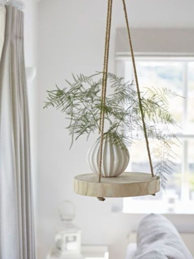 Cool And Easy Hanging Shelf Of A Thick Wood Slice And Ropes
