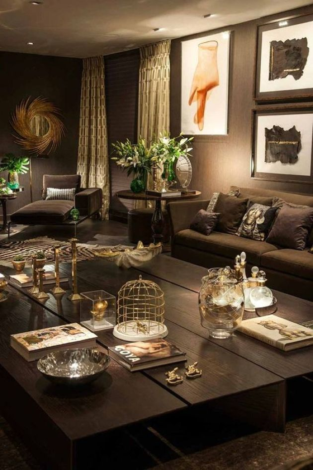 Dark Chocolate Living Room With Metallic Accents And Greenery