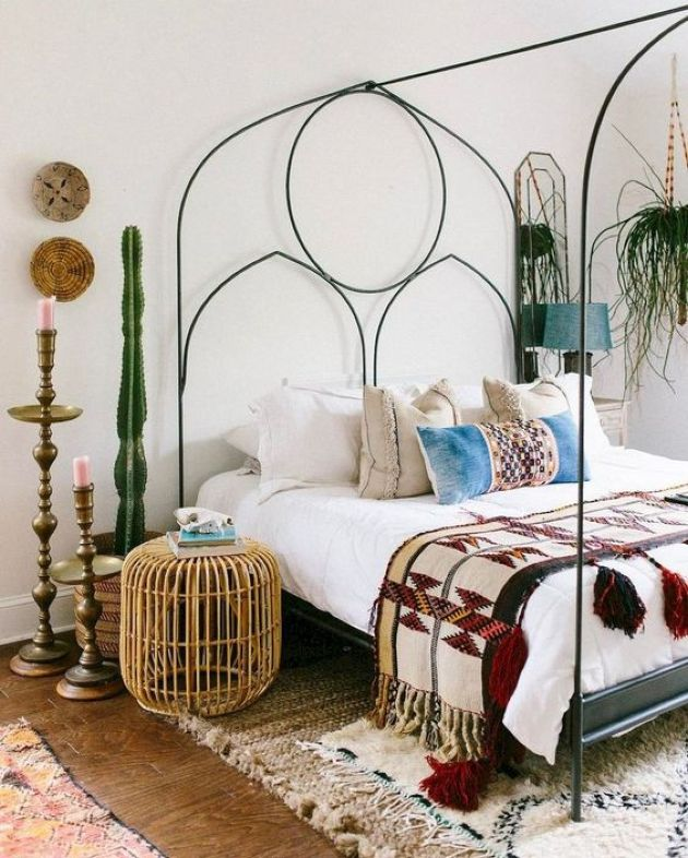 Eclectic Bedroom With A Metal Bed With Decor