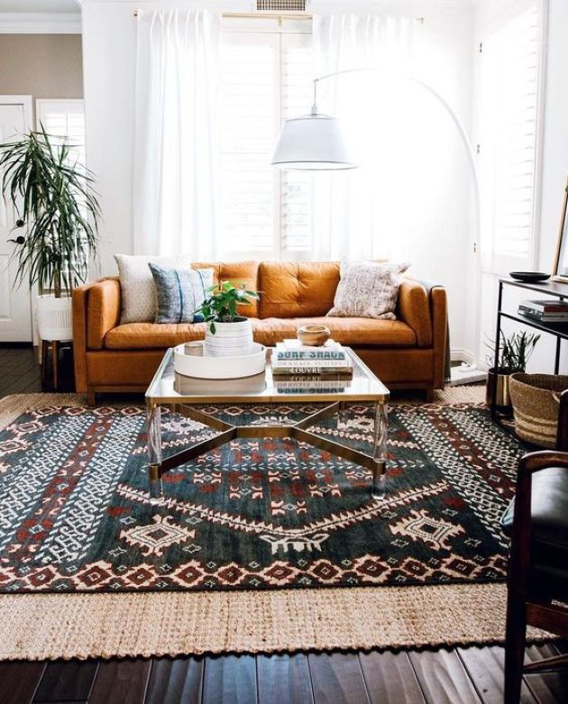 Eclectic Living Area With A Folksy Rug Plus A Floor Lamp